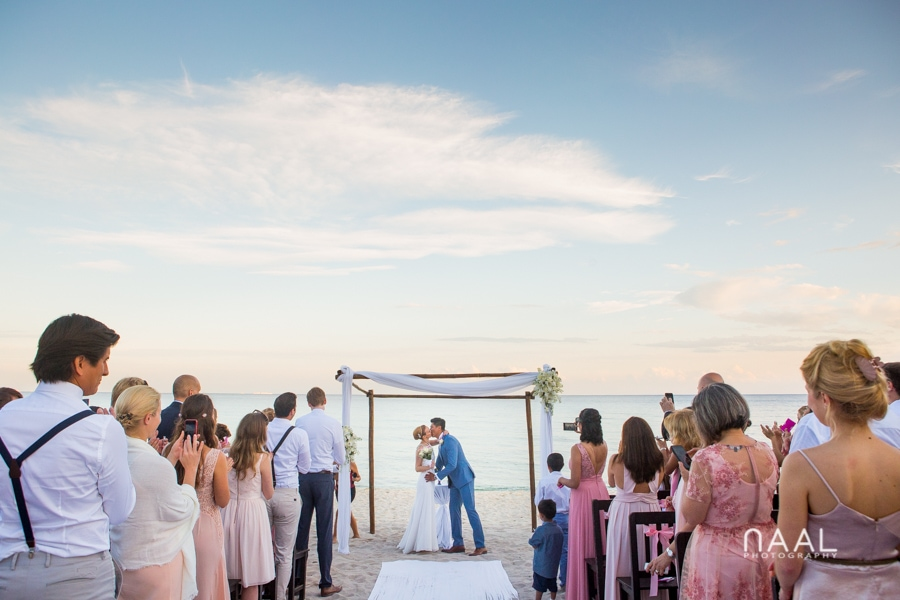first kiss bride and groom at Blue Venado beach Club by Naal Wedding Photography