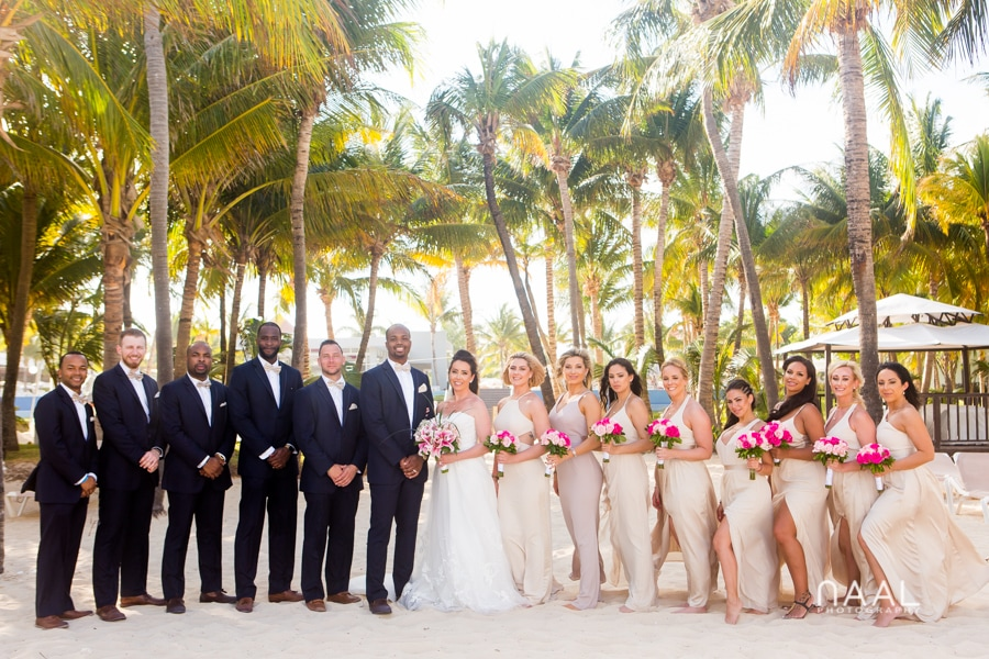 wedding party at riu palace mexico destination wedding by Naal Wedding Photography