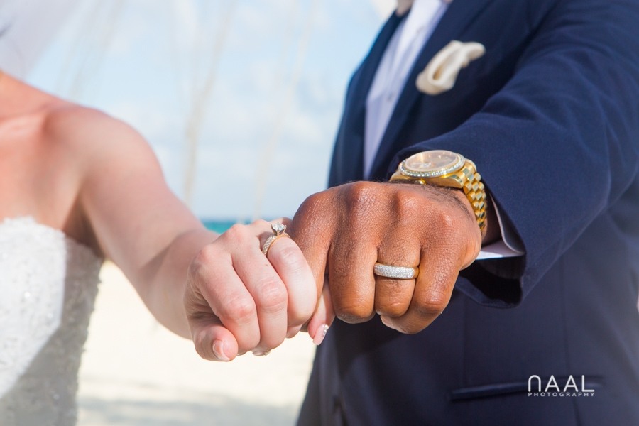 wedding rings at riu palace mexico destination wedding by Naal Wedding Photography