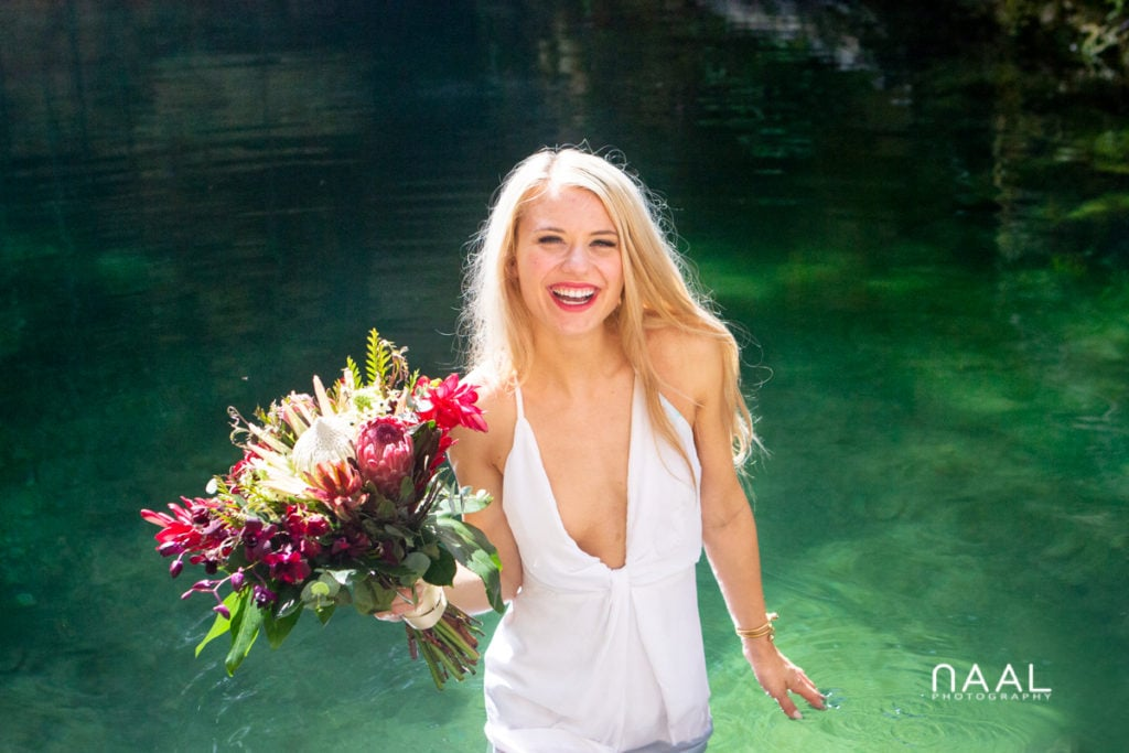 Happy boho bride in exclusive cenote wedding. Naal Wedding Photography